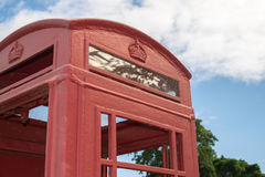 Red British pay phone booth outdoors Stock Photo