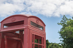 Red British pay phone booth outdoors Stock Photography