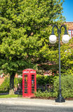 Red British Phone Booth. Red British telephone booth in town of Mount-Royal,Quebec, Canada Stock Image