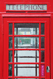 Red British Phone Box. Detail of an Old Red British Phone Box on a London Street Stock Image