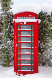 Red British phonebox in the snow Royalty Free Stock Photography