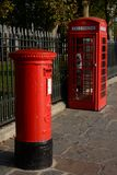 Red British Post Box and Telephone Box. London. England Royalty Free Stock Photography