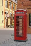 Red British telephone booth. In Moscow Royalty Free Stock Photo
