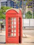 Red British Telephone Booth. Old and rustic Stock Photography