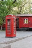Red British telephone booth. In Moscow Stock Image