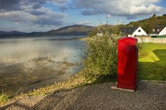 British telephone box on the shore of Kentallen. Loch Linnhe, Argyll and Bute, Highlands, Scotland, UK royalty free stock images