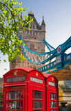 Red British telephone box in front of Tower bridge, London Stock Photos