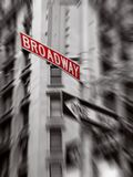 Red broadway sign. Black and white photo, zoom blur stock image