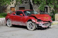 The red broken car after accident. Stock Photos