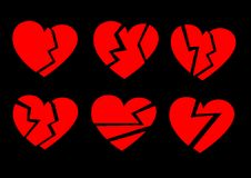 Red broken hearts on a black background Royalty Free Stock Photography