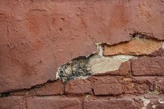 Red broken old brick wall royalty free stock image