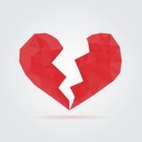 Red broken polygonal heart Stock Images