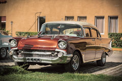 Red-bronze antique car standing against the terrac Royalty Free Stock Photo