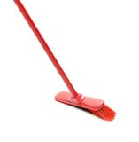 Red broom for cleaning. Royalty Free Stock Images