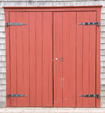 Red Brown Barn Doors to old farm structure Stock Photos