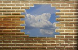 Red, brown brick wall textured background and sky. royalty free stock images