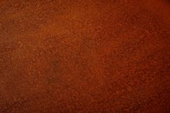 Brushed rusty metal texture background. Red brown brushed rusty metal texture background royalty free stock images