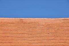 Red brown ceramic roof tiles over blue sky Stock Photo