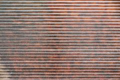 Red-brown fragment of metal blinds Stock Photography