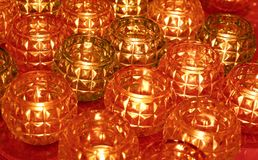 Red and brown glass candle pot pattern background royalty free stock photography