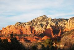 Red and brown layers of the mountains of Sedona, Arizona. The picture shows multi-colored, multi-layered mountains near Sedona, Arizona. This beautiful landscape royalty free stock image
