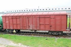 Red brown metal iron freight cars for the train at the railway station royalty free stock photos