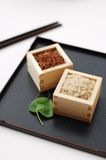 Red and brown rice in square containers Stock Photo