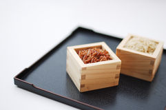 Red and brown rice in square containers Royalty Free Stock Photography