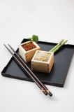 Red and brown rice in square containers Stock Image