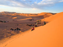 Red and brown sand dunes. With people watching the sunset - Erg Chebbi - Merzouga - Morocco Royalty Free Stock Photo