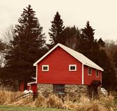 Red, Brown, and White Wooden and Brick House stock photo
