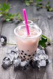 Red bubble tea and black tapioca pearls on crushed ice Royalty Free Stock Photos