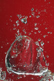 Red bubbles. Air bubbles of weird shapes rising up in the water with a background lit in red light Royalty Free Stock Photos