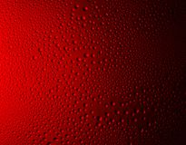 Red bubbles background. Close-up water drops on red gradient glass surface as background Royalty Free Stock Image