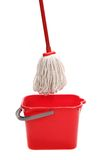 Red bucket with cleaning mop. Royalty Free Stock Photos