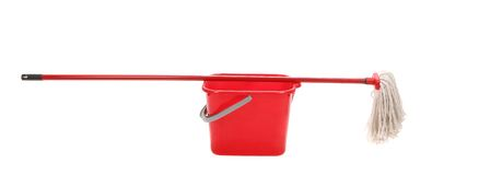 Red bucket with cleaning mop. Stock Photo