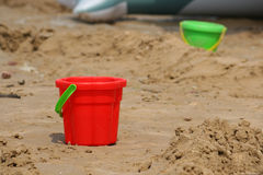 Red bucket on sand Stock Images