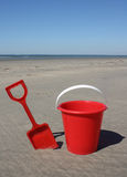 Red bucket and spade Royalty Free Stock Images