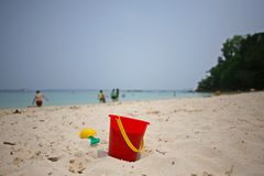 Red bucket and spade on the sand on Manukan Island Stock Photo