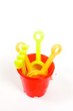 Red bucket and toys, isolated on white Stock Image