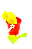 Red bucket and toys, isolated on white background Stock Image