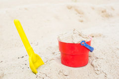Red bucket and yellow spade Stock Images