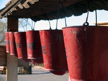 Red buckets. Six red fire buckets hanging in a row stock images