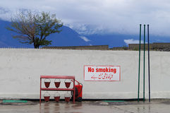 Red buckets in the gas station in Northern  Pakistan Royalty Free Stock Images
