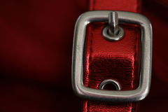 Red buckle. Closeup of shiny buckle on red fabric Royalty Free Stock Photos