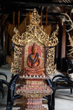 Red Buddha carved wood Royalty Free Stock Image