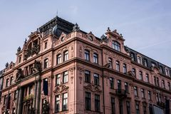 Red building in baroque style on Wenceslas Square stock images