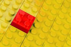 Red building block in yellow Stock Photo