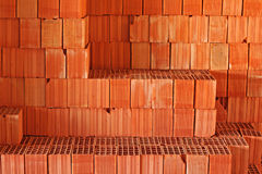Red building blocks on construction site Stock Images