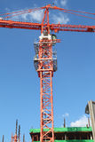 Red building crane at construction site Royalty Free Stock Photo